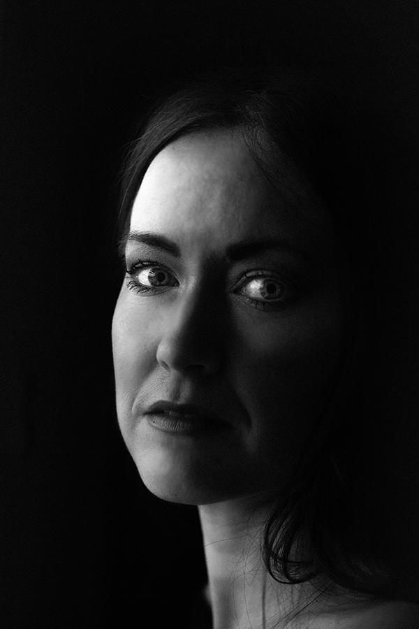 Black and white portrait of woman by Hanne Brooks Photography