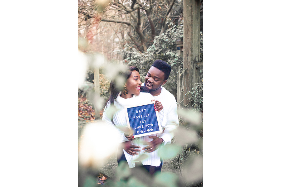 Couple smiling and celebrating pregnancy by Hanne Brooks Photography