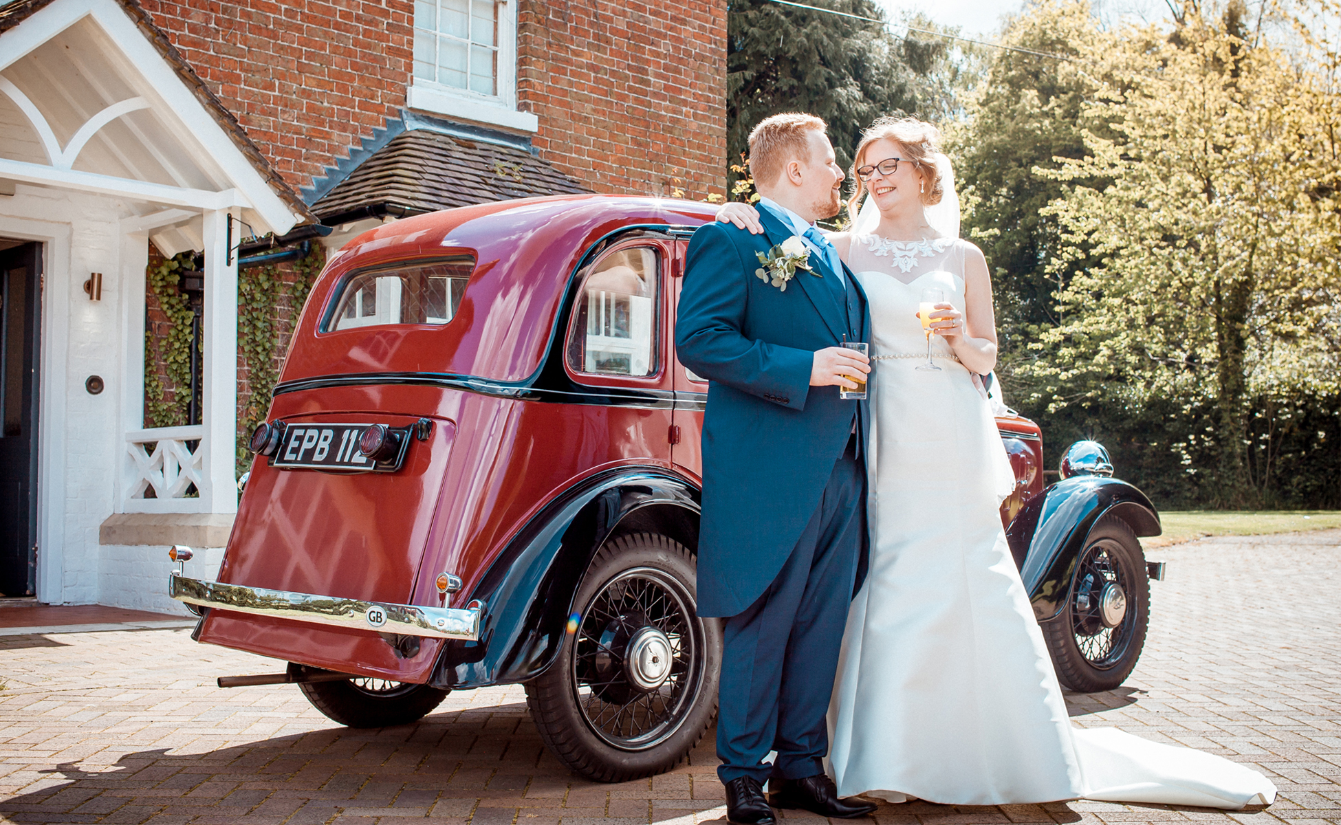 Couple stand outside house before wedding by Hanne Brooks Photography