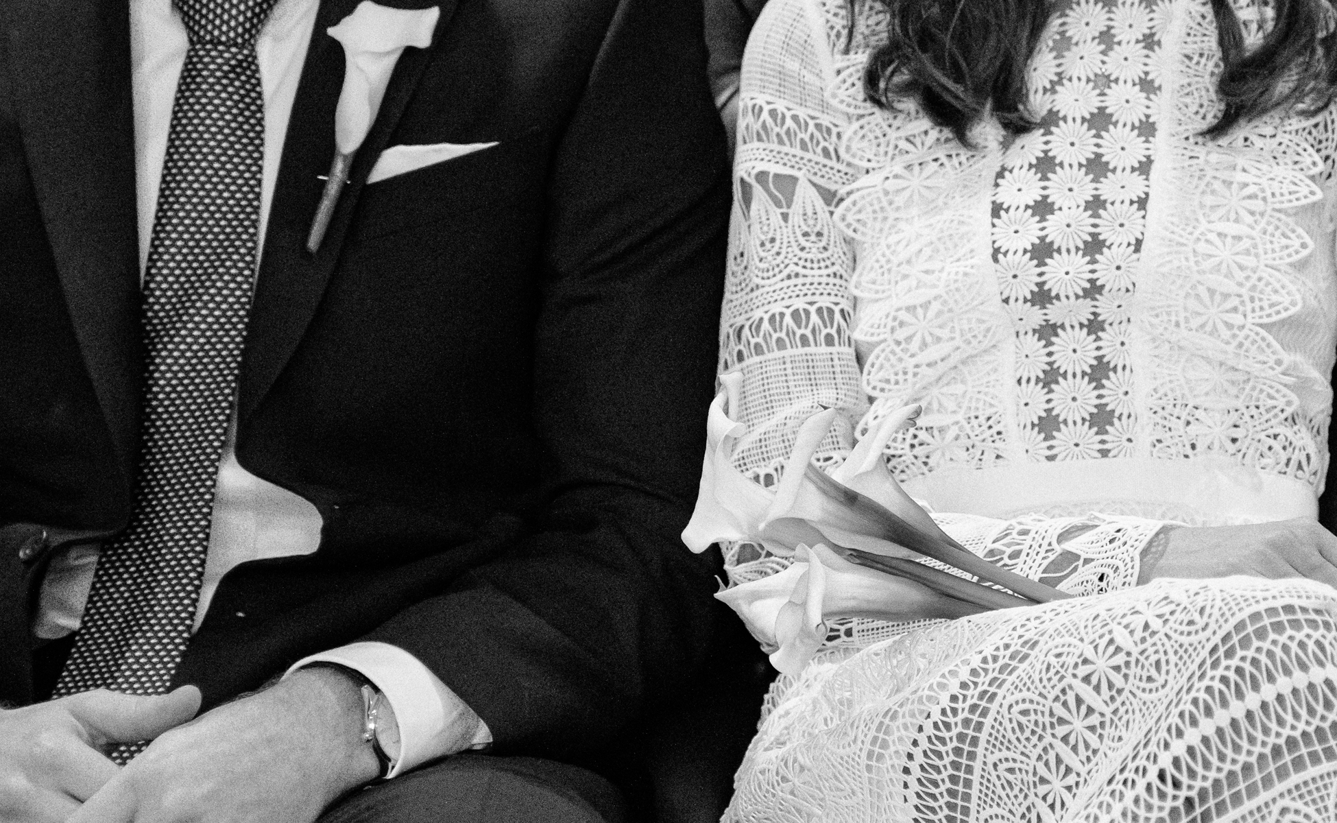 Couple sit together at wedding by Hanne Brooks Photography