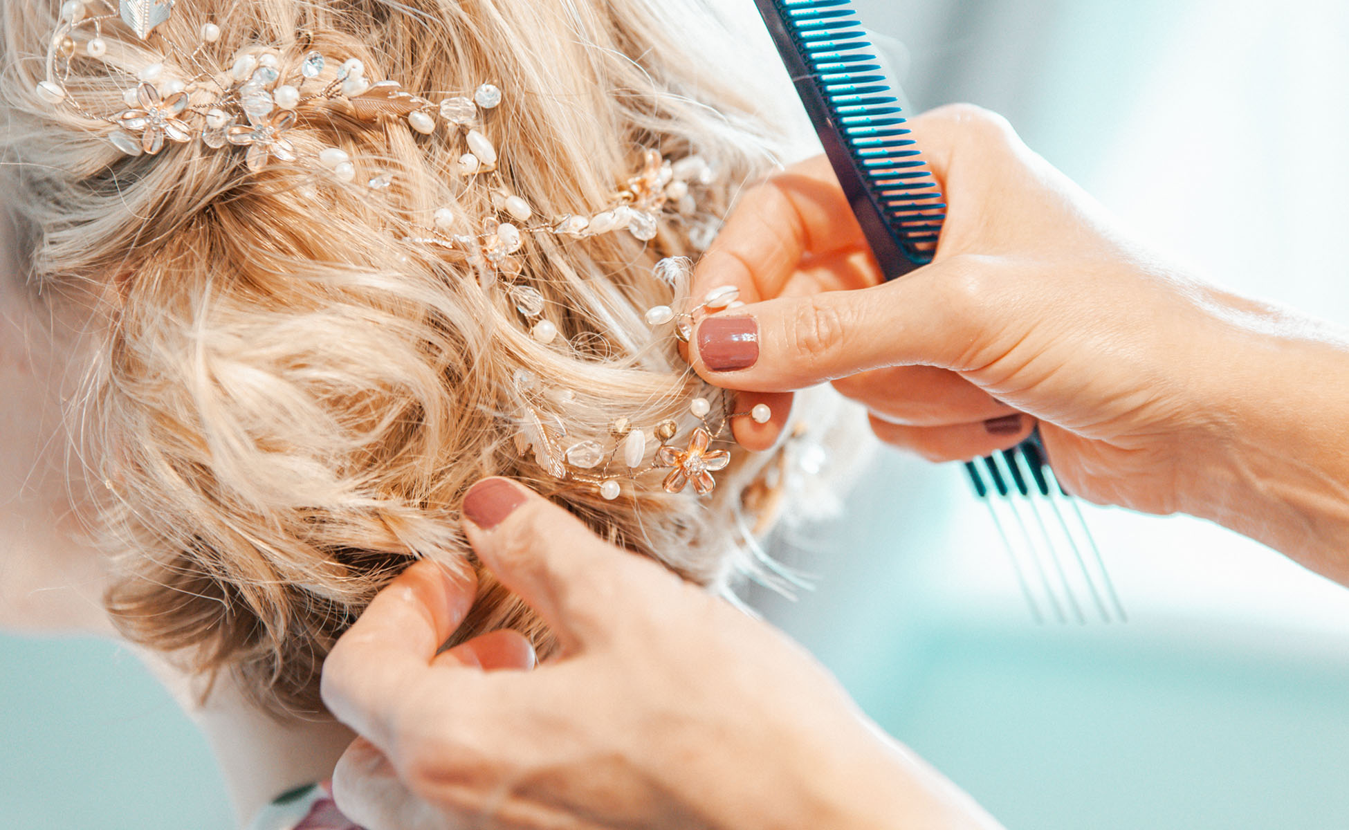 Bride's hair being styled before wedding by Hanne Brooks Photography.
